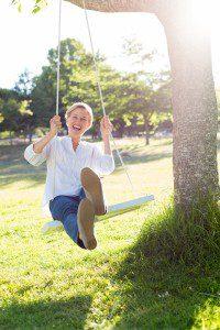 Girl on a tree swing